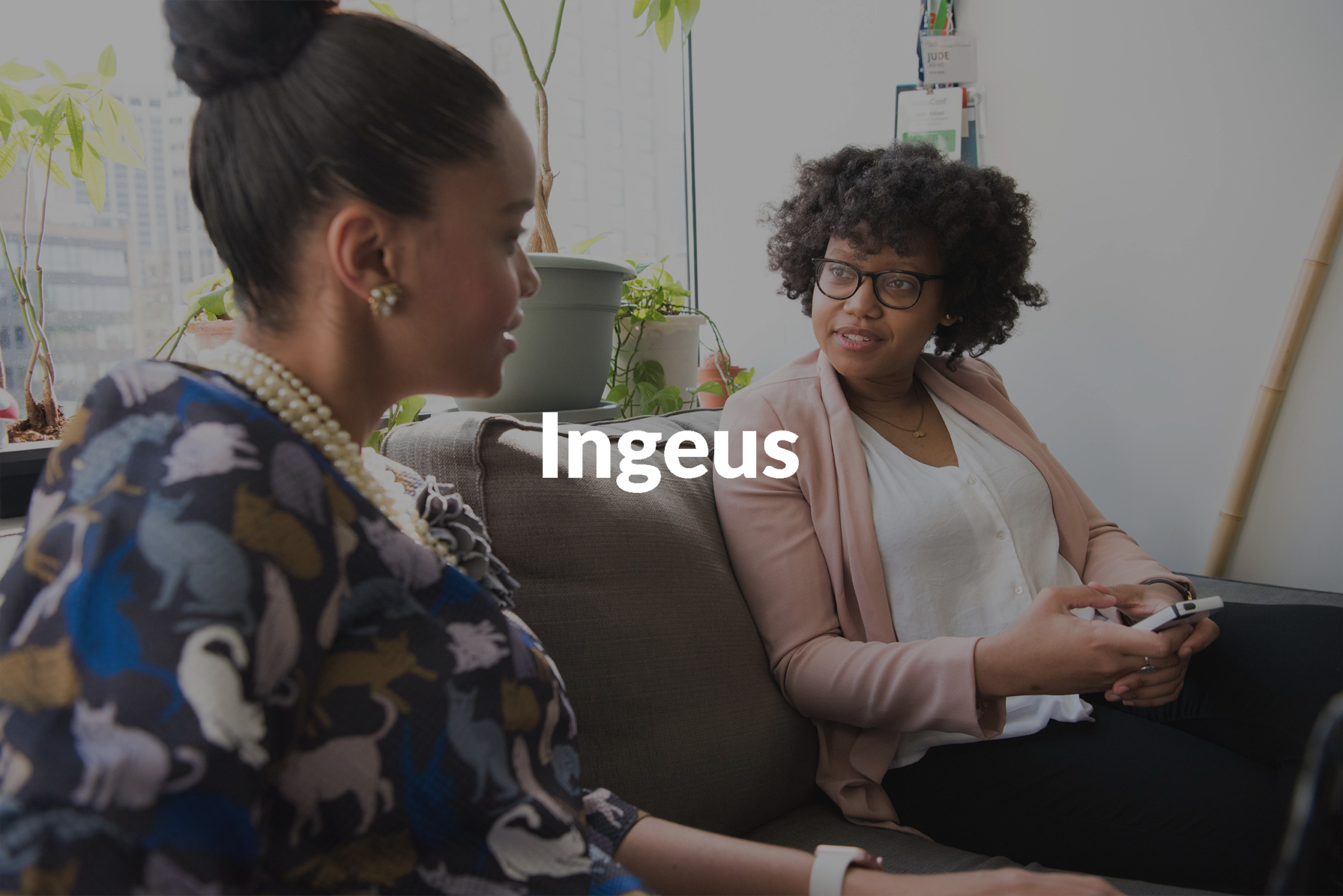 Image of two people talking with the text Ingeus over the top of the image